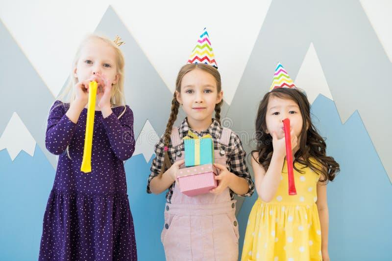 Having fun at childrens birthday party stock photos