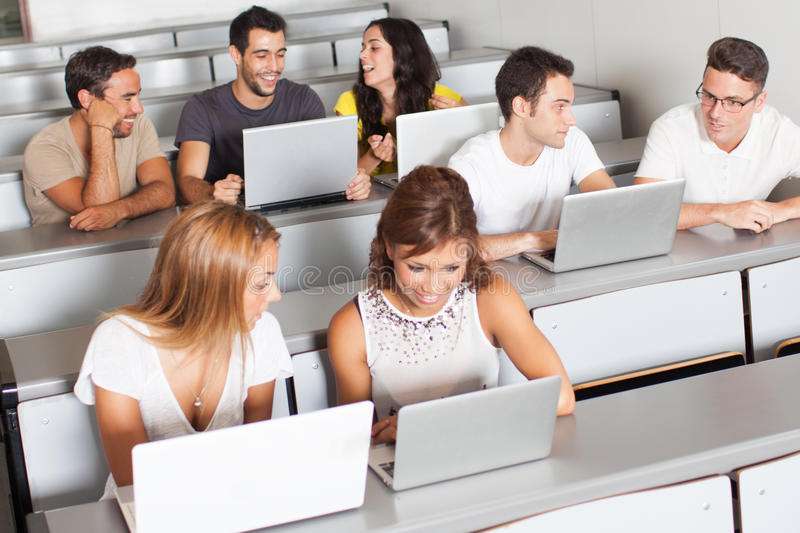 Having fun in class. Students having fun while studing class on the laptop royalty free stock photos