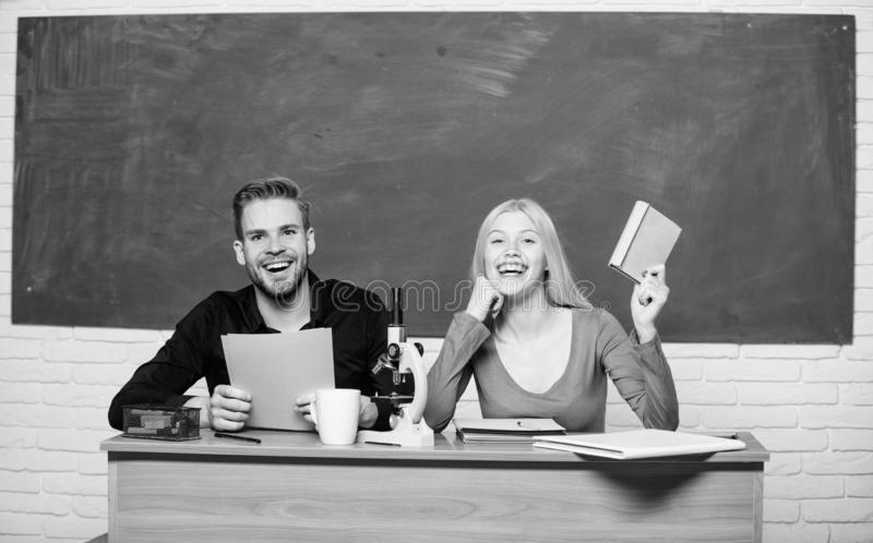 Having fun in college. Carefree students. Enjoying time in college. Guy and girl sit classroom. Studying in college or stock image