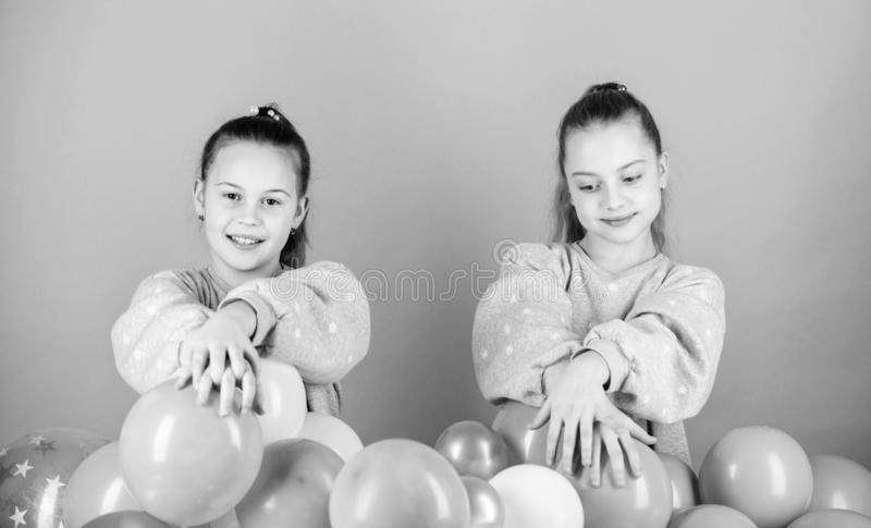 Having fun concept. Balloon theme party. Girls best friends near air balloons. Start this party. Birthday party. Happiness and cheerful moments. Carefree royalty free stock photography