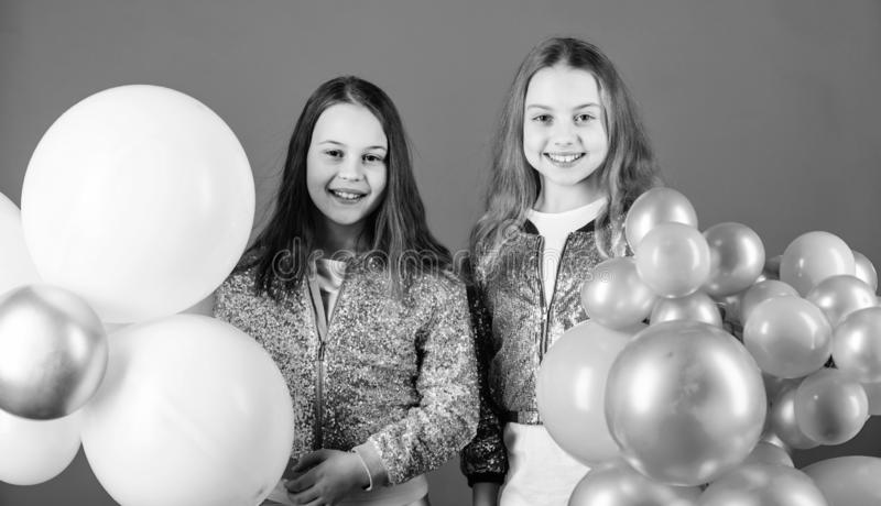 Having fun concept. Balloon theme party. Girls little siblings near air balloons. Birthday party. Happiness and cheerful royalty free stock photo