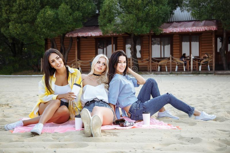 Having fun concept. Group of young cheerful women having fun on the beach royalty free stock photography