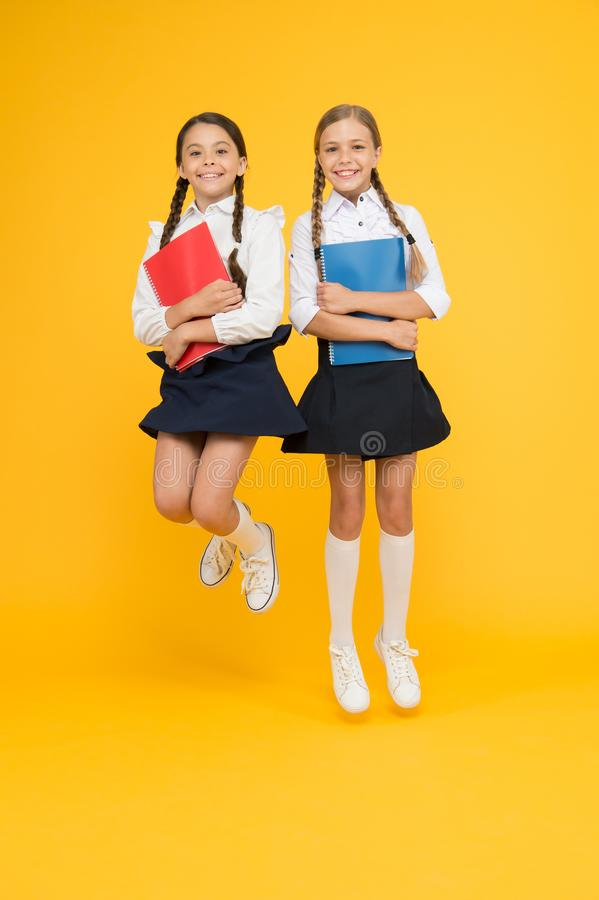 Having fun. dictionary notebook. Get information. reading story. childrens literature. cheerful classmates with workbook stock photos
