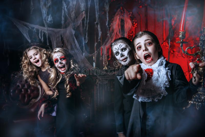 Having fun at halloween. Halloween. Group of children in carnival costumes in the old castle royalty free stock image