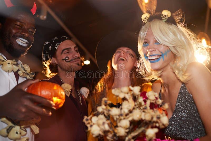 Having Fun at Halloween Party in Nightclub royalty free stock image