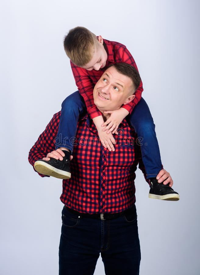 Having fun. Happiness being father of boy. Fathers day. Father example of noble human. Father little son red shirts. Family look outfit. Best friends forever royalty free stock photo