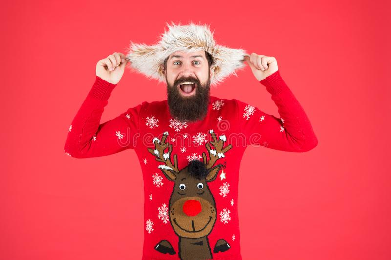 Having fun. hipster with beard in favorite sweater. knitwear and fur accessory. happy new year. merry christmas. male royalty free stock photo