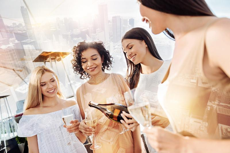 Joyful happy women drinking alcohol together stock photography