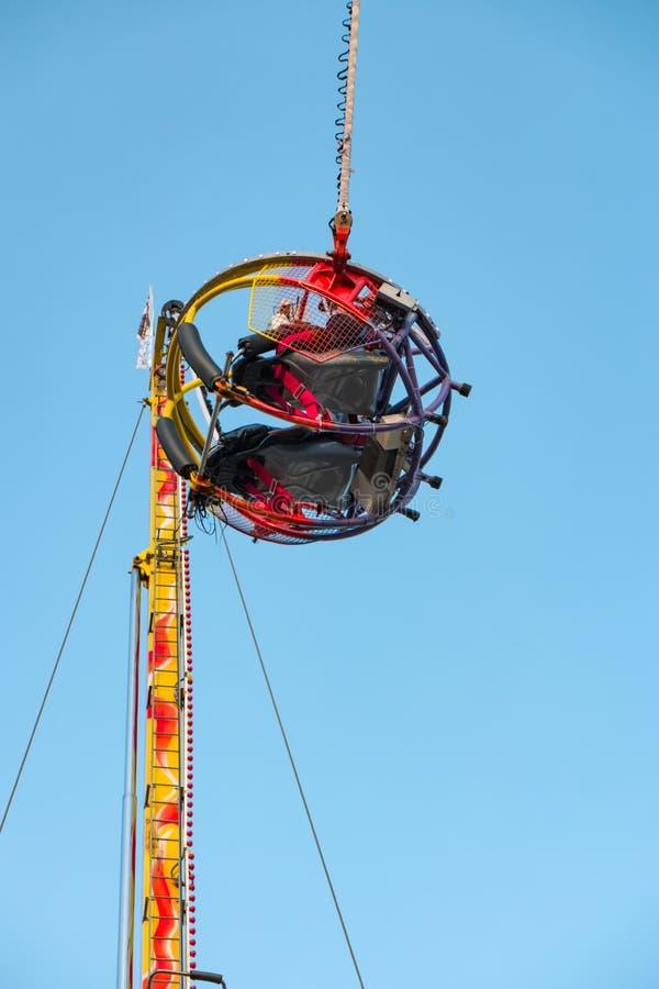 Having fun on reverse bungee in amusement park stock photo