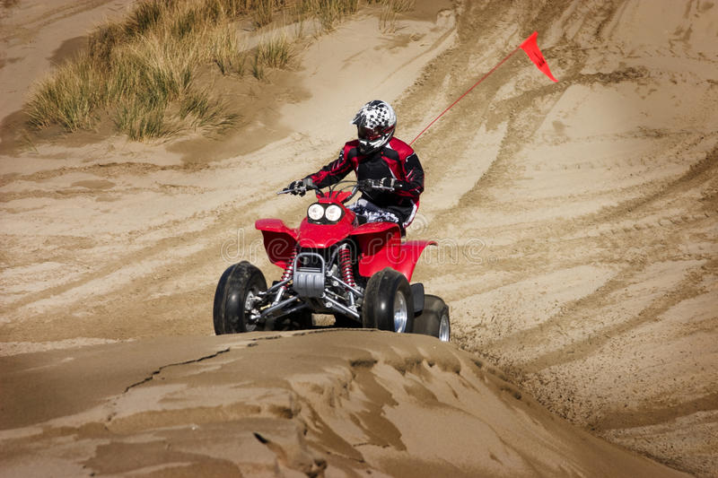 Having fun riding sand dunes stock image