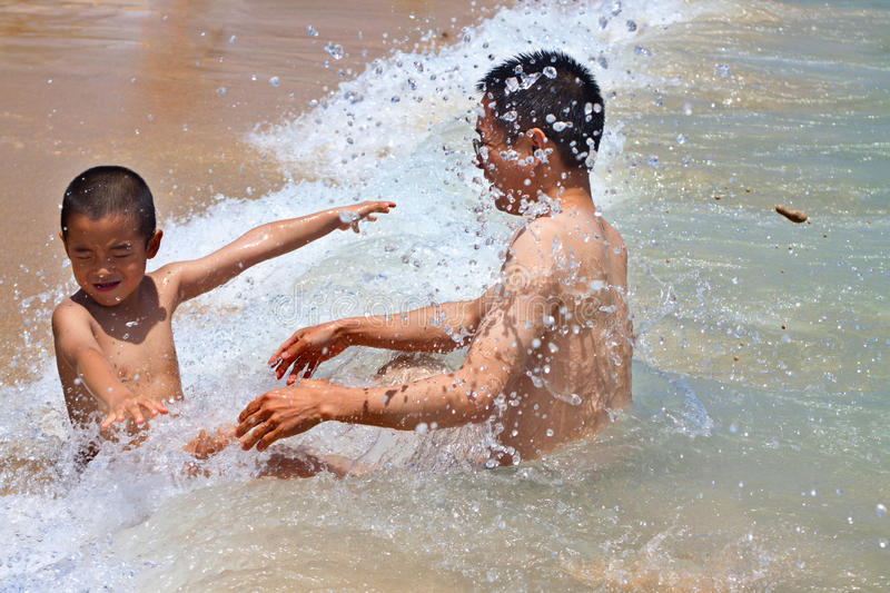 Summer family vacation, Hawaii. Dad and son playing on beach, having fun. happy travel