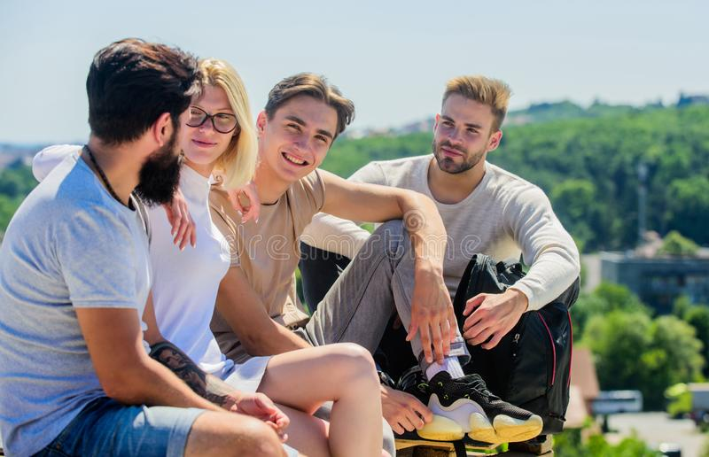 Having fun together. group of four people. great fit for day off. best friends. Summer vacation. happy men and girl. Relax. Group of people in casual wear royalty free stock photo