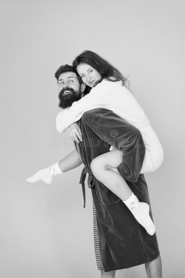 Having fun. woman and bearded man in robe. Perfect morning. Happy family. romantinc couple in love. romantic family royalty free stock photography