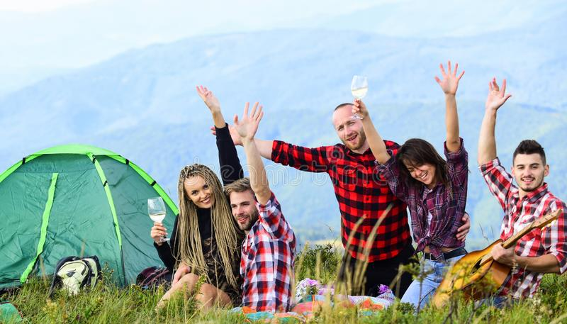 Having great time together. men and women on picnic at tent. wanderlust discovery. mountain tourism camp. group of stock photo