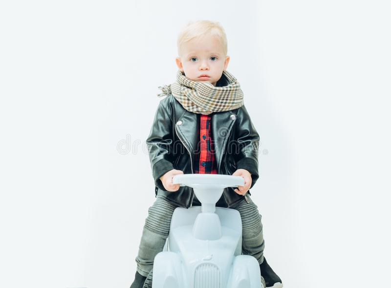 Having a joy ride on his lovely car. Little child ride on toy car. Small toddler builds balance and motor skills. Boy. Child on riding toy. Little baby enjoy royalty free stock photos