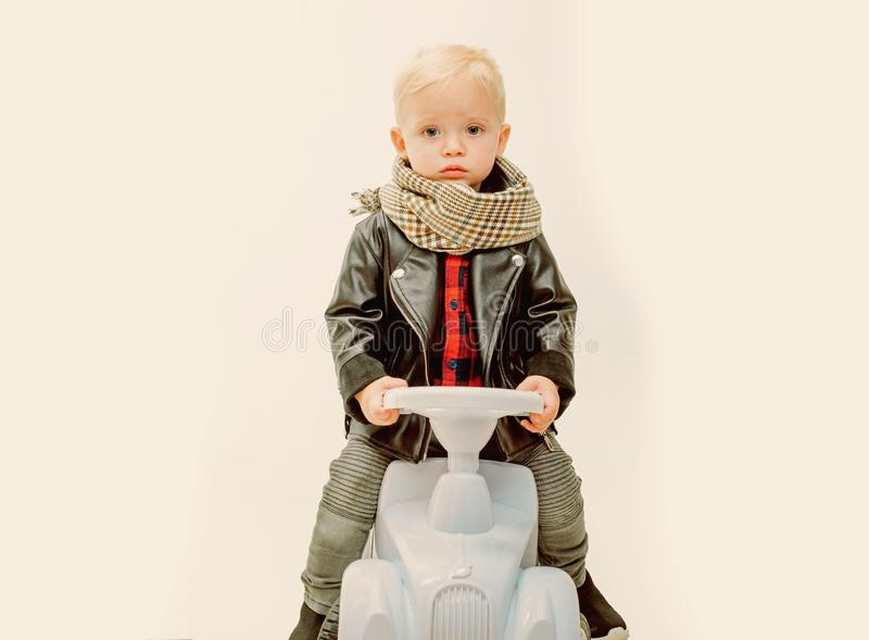 Having a joy ride on his lovely car. Little child ride on toy car. Small toddler builds balance and motor skills. Boy. Child on riding toy. Little baby enjoy royalty free stock photo