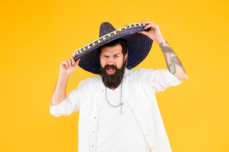 Having mexican soul. Mexican traditions. Explore mexican culture. Celebrate traditional holiday. Happy man sombrero. Souvenir straw hat. Plan summer vacation stock image