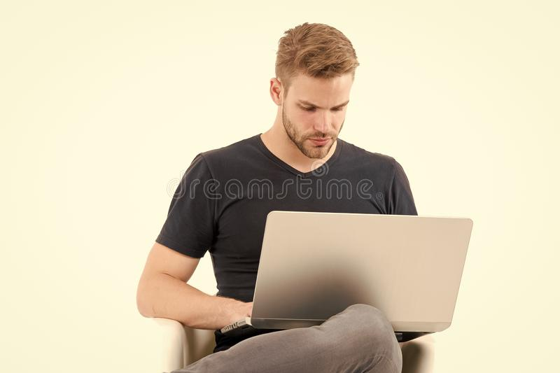 Having so much work to do. Man with laptop busy concentrated face planning. Guy handsome unshaven in black shirt works. Computer isolated white. Man busy with stock images