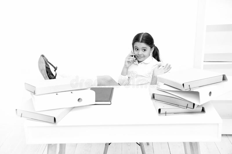 Having pleasure. Schoolgirl developing communication skills. Small school child having phone call. Little girl talking royalty free stock photo