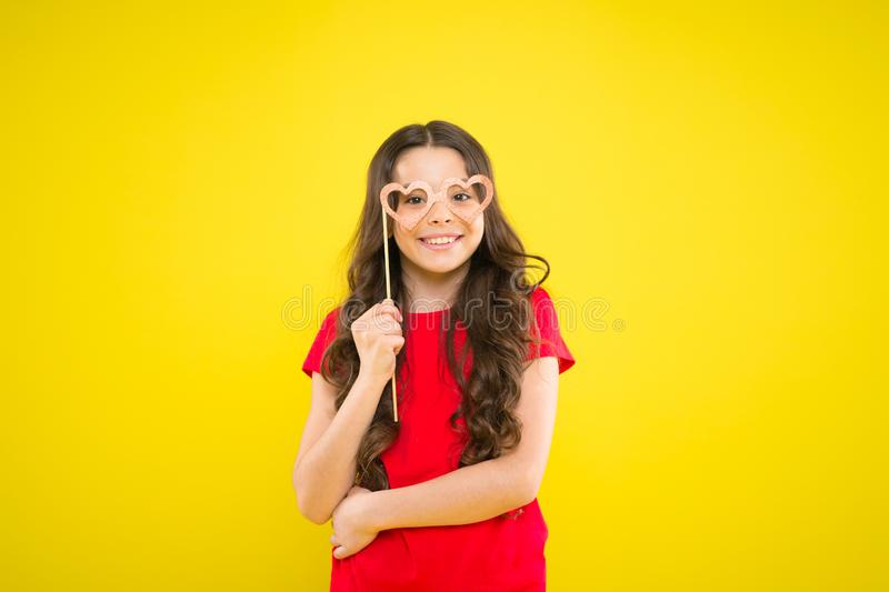 Having real fun. prepare for party. happy girl at yellow wall. summer fashion. small girl with party glasses. small girl stock photography