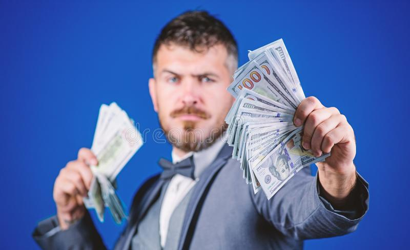 Having a rewarding job. Making money with his own business. Bearded man holding cash money. Currency broker with bundle. Of money. Rich businessman with us royalty free stock photos