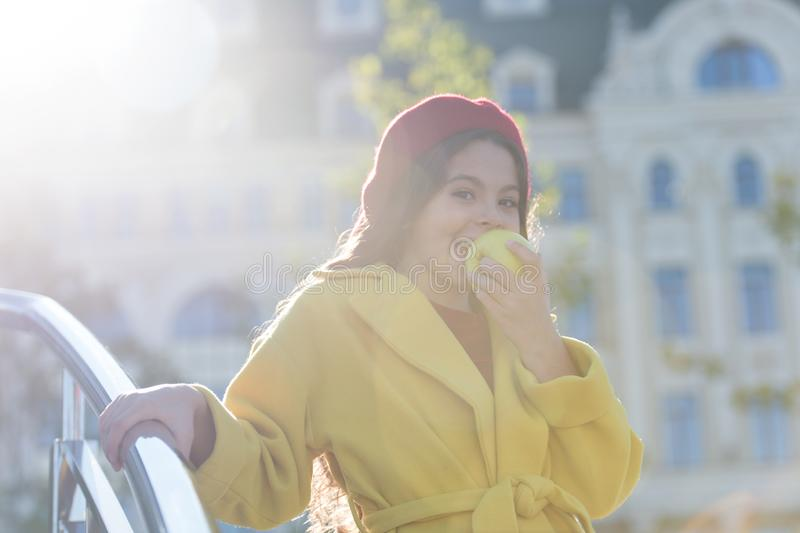 Having snack. Good nutrition essential good health. Kid girl eat apple fruit. Healthy diet. Snack while walk. Kids. Health and nutrition. Healthy snacking royalty free stock image