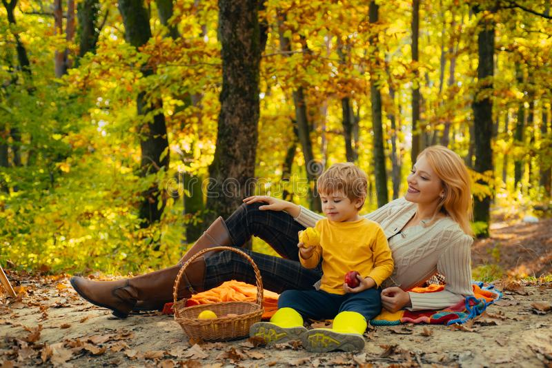 Having snack picnic hike. Happy childhood. Teaching son healthy nutrition. Mom and kid boy relaxing while hiking forest stock photos