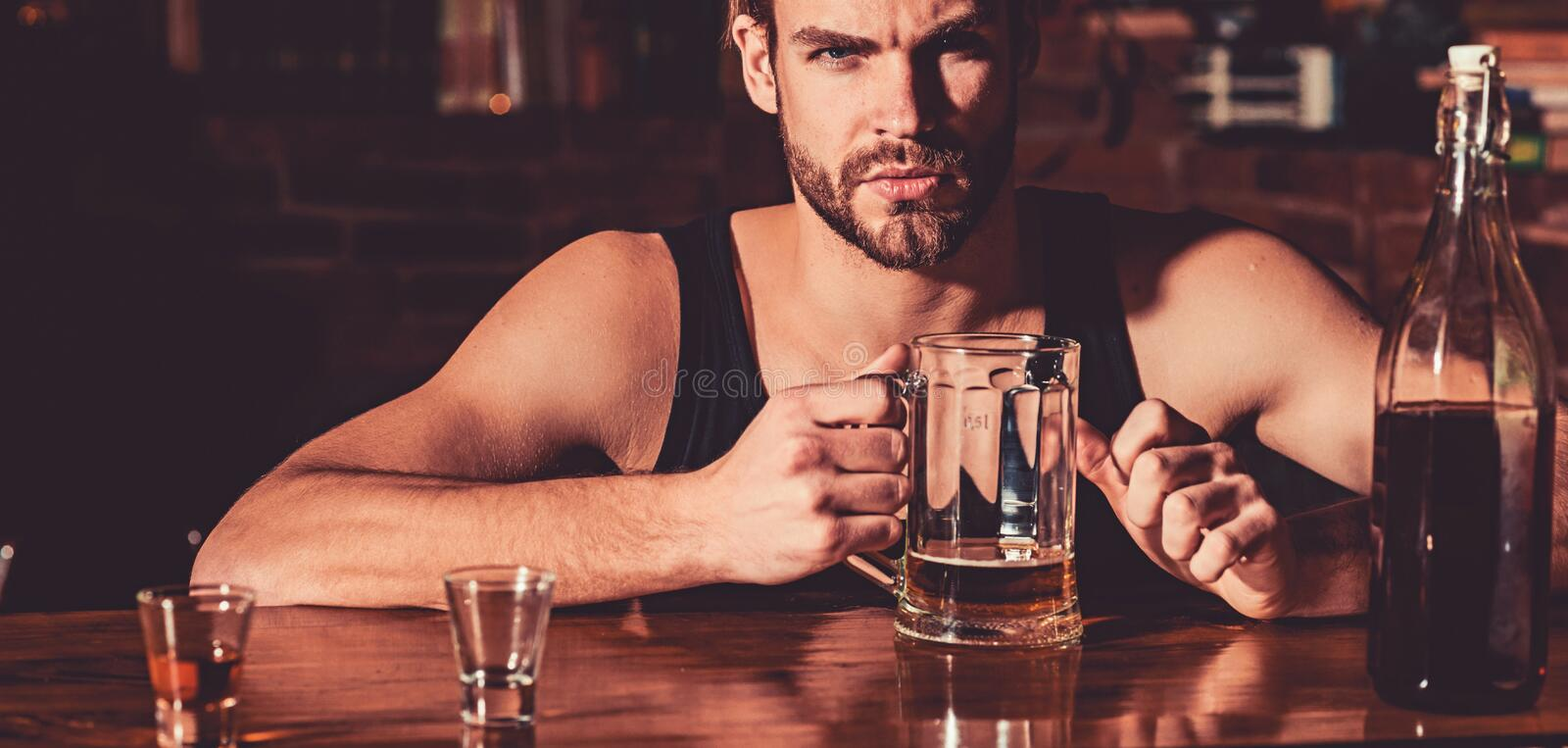 Having some beer. Alcohol addict with beer mug. Man drinker in pub. Handsome man drink beer at bar counter. Beer. Restaurant. Alcohol addiction and bad habit royalty free stock photography