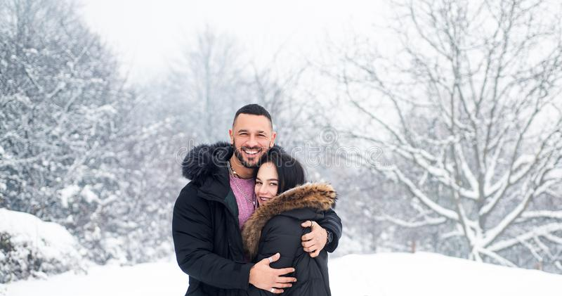 Having warm feeling and relationship. Couple in love wearing warm clothes in winter. Sensual woman and handsome man stock image