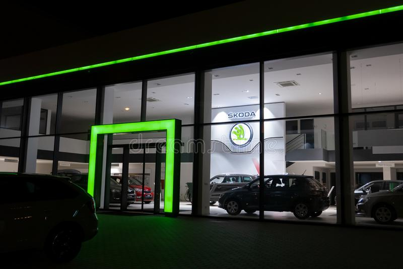 HAVIROV, CZECH REPUBLIC - NOVEMBER 2, 2018: Dealership of a Czech Skoda Auto brand in Havirov in evening hours with a green stock photography