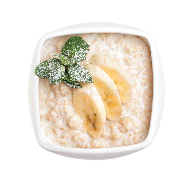 Havremjölhavregröt med bananen för bunkemapp för ai tillgänglig oatmeal royaltyfri foto