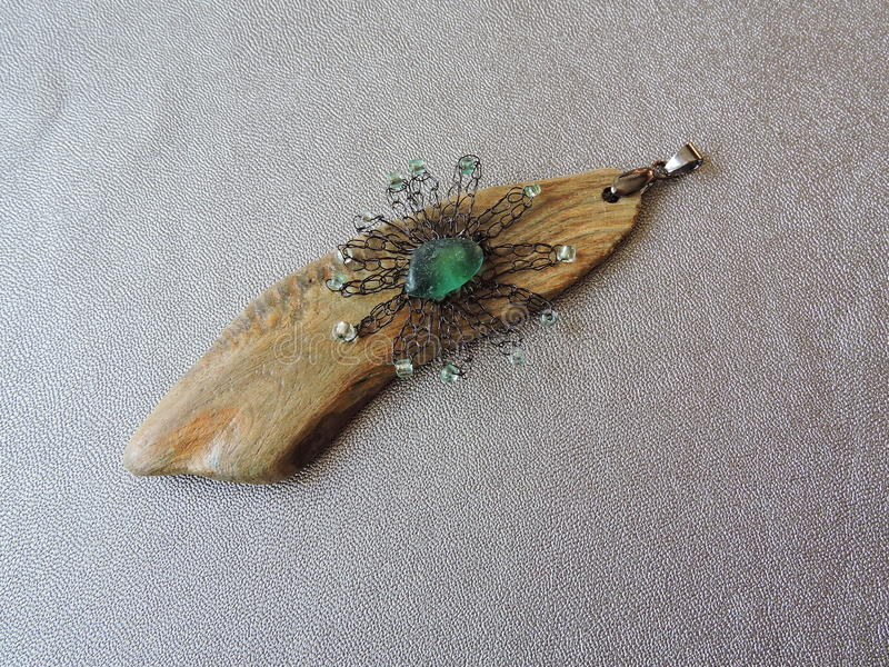 Havsdrivvedhänge arkivbild