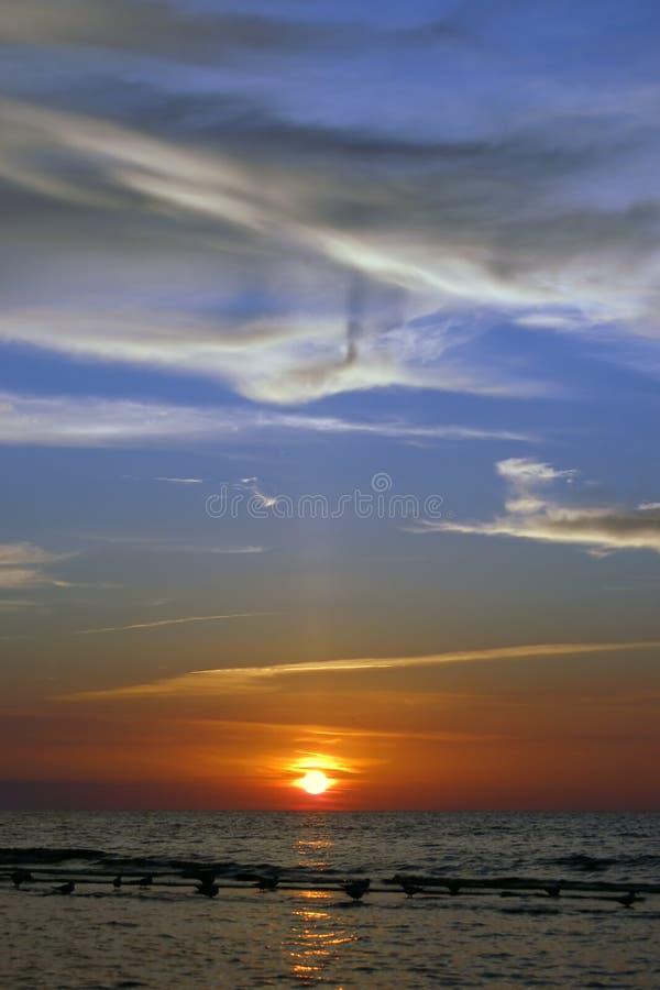 havssolnedgång royaltyfri foto