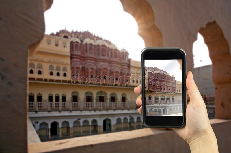Hawa Mahal or Palace of Winds, Jaipur, India. Taking photo on sm. Art phone concept stock photography