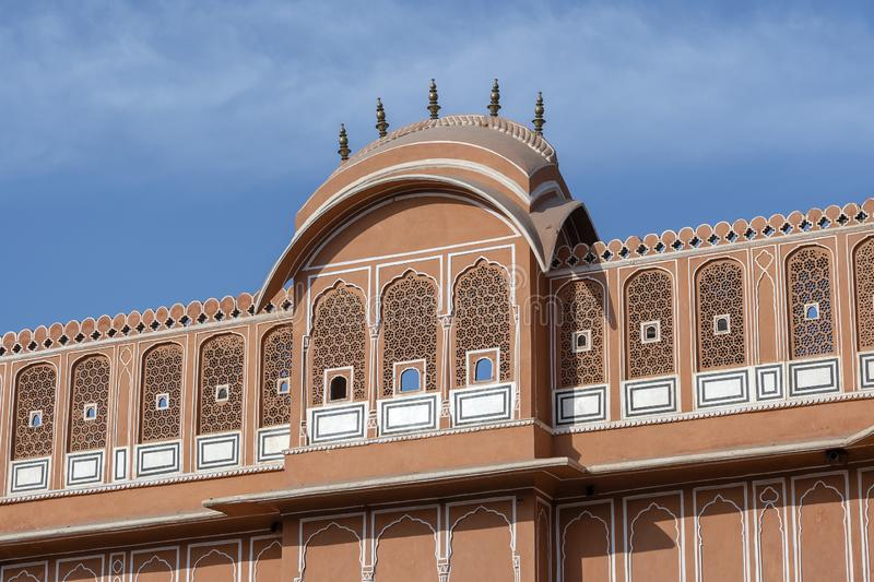 Hawa Mahal, pink palace of winds in old city Jaipur, Rajasthan, India. Background of indian architecture, close up stock image