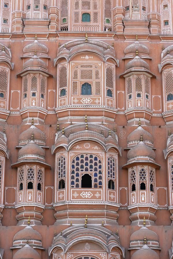 Hawa Mahal, pink palace of winds in old city Jaipur, Rajasthan, India. Background of indian architecture, close up stock photo