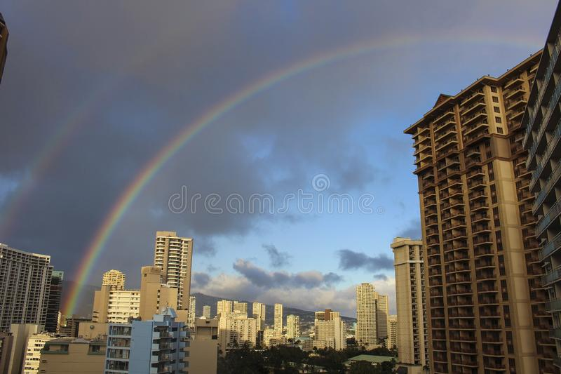 Hawaii buildings downtown Honolulu rain bowl royalty free stock photos