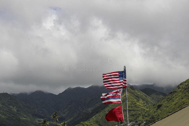 Hawaii Honolulu American flag. On a cloudy day with mountain on the background stock photo
