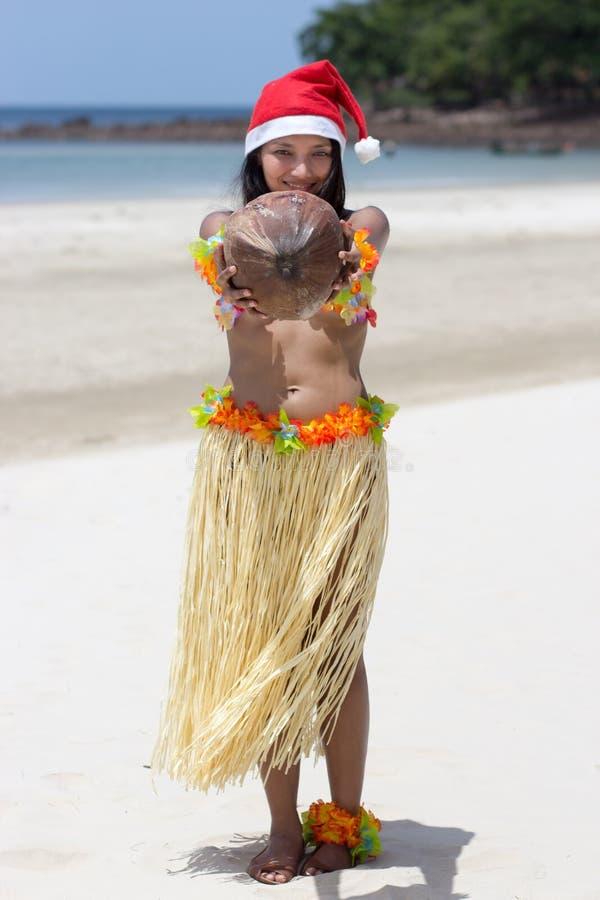 Hawaii hula dancer. With coconut on beach stock photography