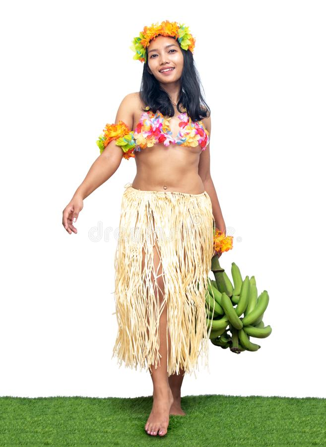 Hawaii Hula Dancer carries bunch of green bananas,. Isolated on white background. Ethnic woman hold fresh tropical fruits stock photo
