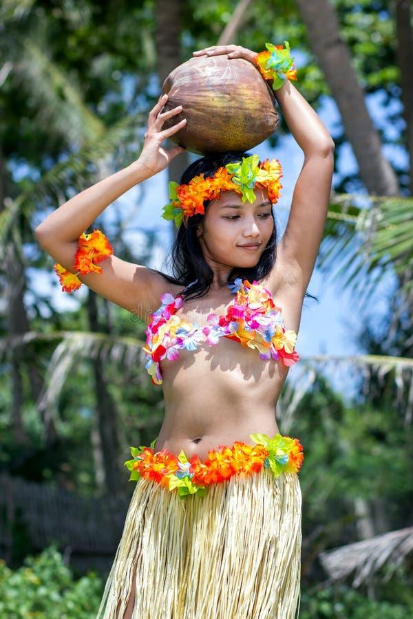 Hawaii hula dancer carries coconut. Hawaii hula dancer hold coconut on her head royalty free stock photos