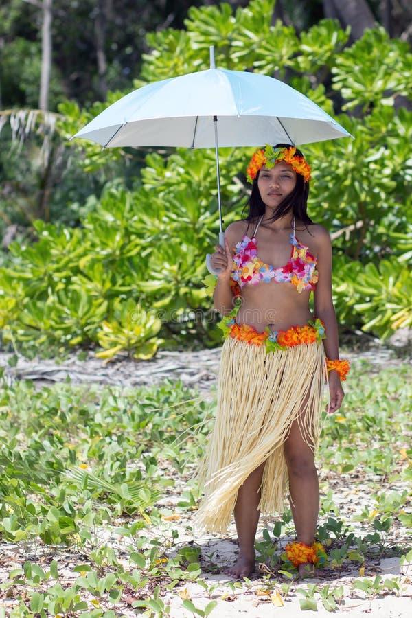 Hawaii hula dancer. Holding umbrella stock photos