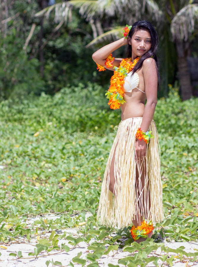 Hawaii hula dancer. Posing in tropical nature royalty free stock photography