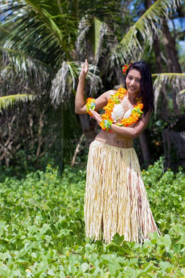 Hawaii hula dancer. In tropical nature stock image