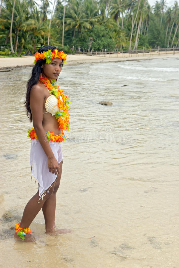 Hawaii Hula dancer. Walking in the sea stock images