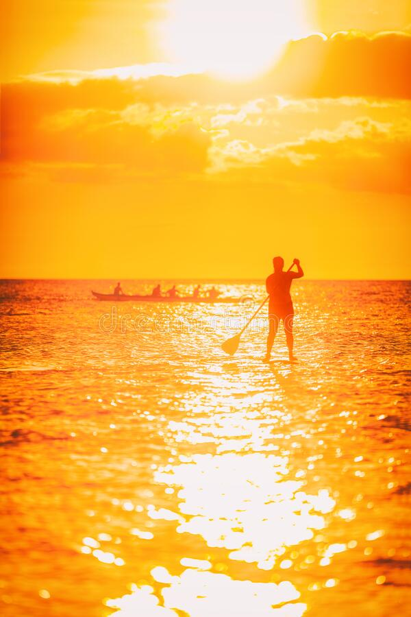 Free Hawaii Ocean Lifestyle - Watersport Activity On Ocean - Stand Up Paddleboard, People Training On Outrigger Canoe Royalty Free Stock Photo - 207778965