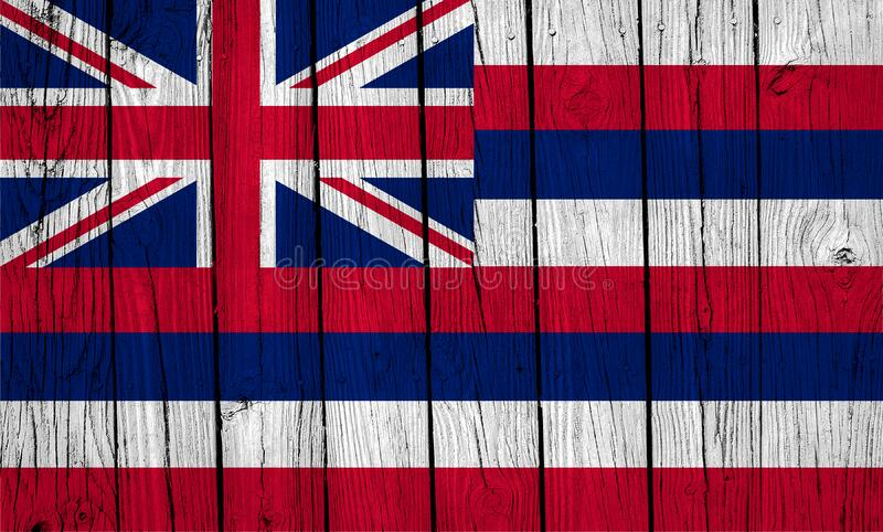 Hawaii State Flag Over Wood Planks. A grunge Hawaii state flag over wood planks royalty free stock image