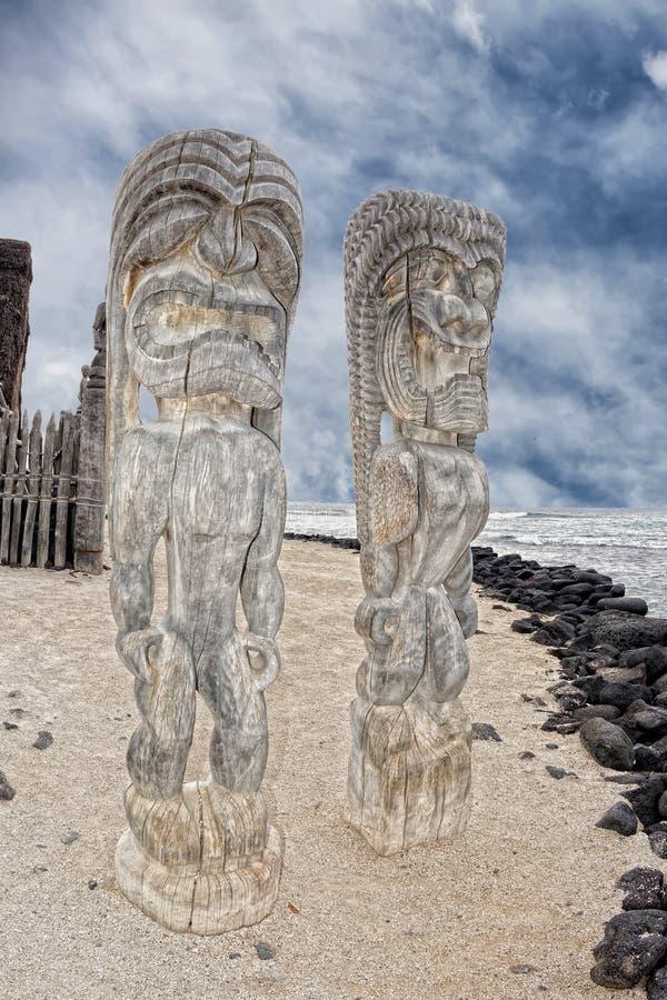 Hawaii Tiki wooden statue. Hawaii Polynesian Tiki wooden statue on the shore stock photo