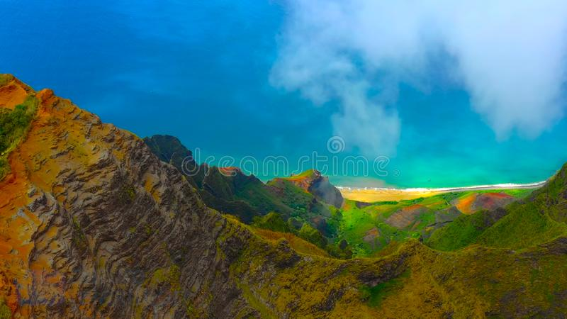 Hawaii travel aerial background of Na Pali coast, Kauai, Hawaii helicopter view. Nature coastline landscape in Kauai island, Hawai. I, USA. Panoramic banner crop royalty free stock images