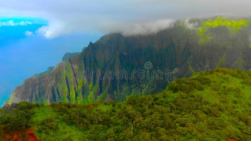 Hawaii travel aerial background of Na Pali coast, Kauai, Hawaii helicopter view. Nature coastline landscape in Kauai island, Hawai. I, USA. Panoramic banner crop royalty free stock photography